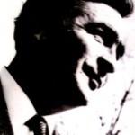 Портрет на Ацо Шопов кој послужи за модел на логото на неговиот Лирски дом. Автор на логото е неговиор внук Александар Џони-Шопов.